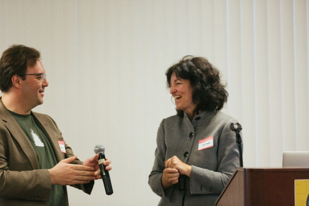 Burbio founder Julie Roche laughs with HV Tech and EMN founder Dan Stone.